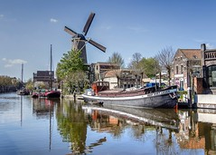 You cannot make a windmill go with a pair of bellows (Peter Jaspers) Tags: blue sky history mill windmill clouds reflections harbour olympus panasonic vest omd flourmill redlion gouda 2016 deroodeleeuw em10 cornmill hoopdoetleven turfsingel harbourmuseum museumhaven 20mm17 buurtje frompeterj hopegiveslive