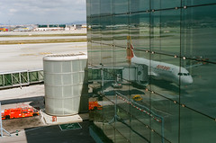Reflection (j.borras) Tags: barcelona film airplane taxi bcn negative airbus fm2 departing a320 pushback iberia portra400 sooc lebl