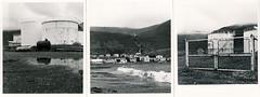Tanks and Houses in Siglufjörður (raf6x6) Tags: blackandwhite wet rain fence puddle island iceland triptych dorf village rainyday tank minolta kodak north wave raf twinlens dup siglufjörður autocord triptychon 13x8 eco4812 bromesko