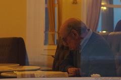 Portrait (Natali Antonovich) Tags: winter portrait window reading restaurant glasses newspaper seaside belgium belgique belgie profile lifestyle read relaxation oostende seashore seasideresort reverie belgiancoast seaboard newspaperreader
