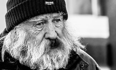 A beard well travelled (pootlepod) Tags: street old winter boy portrait people blackandwhite man male nature monochrome look hat sex closeup out naked beard nose photography eyes alone close natural near pavement candid profile perspective january moustache traveller sidewalk mature elderly tired haggard thinking worn pensive lonely tight hobo tramp vagrant wornout travelled wishful stmarychurch canon60d stphotographia