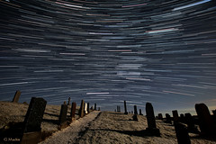 Dizzy (Gordon Mackie) Tags: graveyard scotland moonlit sutherland startrails strathy nightskyphoto