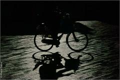Faster than a Shadow (Hindrik S) Tags: light shadow people bike bicycle silhouette dark licht cyclist pavement sony rad shade tamron schaduw silhouet fiets donker radfahrer fietser a57 ljocht tamron1750 sonyalpha tamronspaf1750mmf28xrdiiildasphericalif fyts sonyphotographing skaad tsjuster fytser slta57 57 dnker