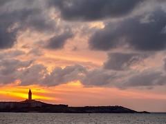 Torre de Hercules (Madiw) Tags: sunset sea sun beach nature atardecer corua olympus galicia puestadesol mera em5 horaazul panasonicgxvario35100f28