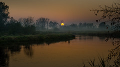 A little anxiety... (piotrekfil) Tags: sunset sky sun mist tree nature water fog wow reflections river landscape twilight riverside pentax dusk poland piotrfil