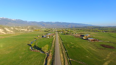 Where Highway 28 Enters Salmon, Idaho (Dan Beland) Tags: road city morning trees houses usa mountains art nature sunrise landscape town unmodified shadows unitedstates cattle artistic barns aerial idaho vista northamerica farms rockymountains verdant lush hereford neighborhoods confluence unedited tiretracks longshadows drone blackangus greenpastures ranches highway28 nofilters ranchland bitterrootmountains straightroad noadjustments dji beaverheadmountains straightoffthecamera salmonidaho salmonrivervalley cattlecountry lemhimountains quadcopter lemhicounty sacajaweacenter phantom3professional lemhirivervalley bentonitefoothills sacajaweascenicbyway ranchproperties