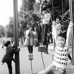 Playground. Hanoi, February 2016 (aryel.beck) Tags: park street playing playground rolleiflex mediumformat children toddler vietnamese child iso400 happiness vietnam kodaktrix hanoi 28e
