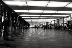 Floor space (b&w) (vinnie saxon) Tags: people urban blackandwhite monochrome architecture shopping nikon floor montreal space wide tokina1224 nikoniste d5300