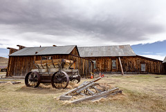 Bodie Wagon (KeithJ) Tags: california abandoned clouds buildings wagon outdoors ghosttown bodie oldwest statehistoricpark monocounty