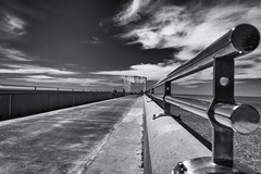 All the way to the end..... (David Feuerhelm) Tags: sea newzealand sky monochrome clouds coast pier seaside nikon outdoor perspective wideangle shore railing napier d7100