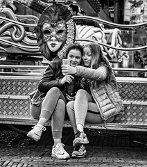 Selfie Faces (Bart van Hofwegen) Tags: street girls haarlem smile face youth fun funny faces expression fair smartphone grimace funfair facebook youngsters selfie leicaq snapchat