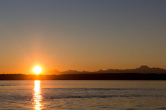 Ray of Hope (Paul Millan 2) Tags: seattle blue sunset orange sun sunlight mountains color nature water lines hope ray line yello