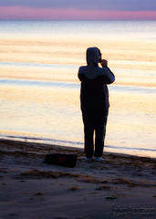 Watching the sunrise (johanbe) Tags: ocean sea people color beach look strand sunrise denmark coast nikon tamron hav soluppgng kust