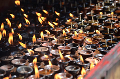 Candle Prayers (Jgunns91) Tags: travel nepal travelling religious temple nikon asia peace buddhism wanderlust explore discover natgeo swayumbhunath