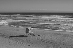 No Lifeguard on Duty (World-viewer) Tags: ocean sea blackandwhite bw tower beach water monochrome beautiful lens landscape 50mm prime bay coast blackwhite seaside md focus waves minolta outdoor f14 sony scenic lifeguard mc hut shore vista manual a6000 mcmd ilce6000