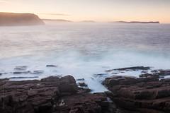foggy evening scene of Signal hill from Cape Spear, Newfoundland (tuanland) Tags: ocean longexposure sunset sea sky seascape canada beach rock newfoundland landscape evening spring nikon waves stjohns clear shore signalhill nfld atlanticcanada capespear d600 avalonpeninsula newfoundlandandlabrador nikond600