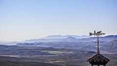 Landscape behind the vane (Ignacio M. Jimnez (antes hermano Montgolfier)) Tags: espaa mountains landscape spain paisaje andalucia weathervane jaen vane andalusia montaas ubeda veleta antoniomuozmolina