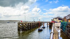 Jetty at Aberdovey (Explored) (williamrandle) Tags: uk sea summer sky seascape water wales clouds reflections landscape boats seaside fishing nikon waterfront harbour outdoor jetty tide shore welsh aberdovey gwynedd 2014 crabpots buoyant d7100 sigma1835f18art