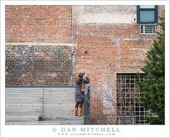 Woman Photographing Brick Wall (G Dan Mitchell) Tags: park street city travel winter urban woman newyork brick wall bench stand chelsea manhattan photograph elevated highline