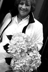 (Chillsea Lei) Tags: woman white black flower smile spain snapshot protrait bouquet streetshot dazzler