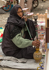 bandari woman smoking pipe at the panjshambe bazar thursday market, Hormozgan, Minab, Iran (Eric Lafforgue) Tags: people woman face vertical outdoors photography women asia veil mask iran market muslim islam hijab culture persia smoking womenonly covered iranian bazaar adultsonly cultural oneperson traditionaldress customs middleeastern sunni balouch hormozgan onewomanonly lookingatcamera  bandari  1people  iro thursdaymarket  minab colourpicture  panjshambe panjshambebazar boregheh iran034i2693