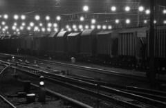 (Sergey Pozolota) Tags: light shadow film night analog train canon dark way wagon blackwhite railway rr rails boxcar ilford ilforddelta400 canonal1