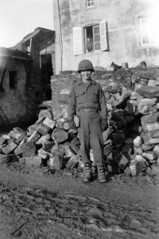 119A-BW-SmilingStaffSgt-Ruins-ETO44-45 (ArgyleMJH) Tags: france germany wwii worldwarii ww2 1945 1944 eto worldwar2 usarmy secondeguerremondiale antiaircraftartillery thirdarmy 119thaaagunbn
