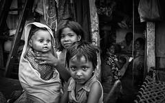 Mirror image at Mumbai's slums. (Thetigerinmyback) Tags: poverty travel baby india look childhood kids nios streetphoto canon5d mirrorimage mumbai mirada infancia slum slums nationalgeographic suburbios markii pobreza intenselook travelphotography fotoperiodismo flickrsbest miradaintensa 5dmarkii fotografiadeviajes flickrtravelaward imagenespejo thetigerinmyback