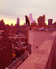 Fantasy- Free falling (AllisonRifkin28) Tags: new york city pink sunset sky newyork color fall yellow skyline fairytale photoshop fun town fly jumping wings downtown pretty over down falling fairy gradient bigapple leaning tale edit neversleeps