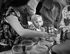 Pout (Anne Worner) Tags: street blackandwhite bw girl monochrome children real outside outdoors mono clothing child sad expression candid patterns streetphotography spoon monochromatic georgetown blond pout expressive sandpainting adults ricohgr scoop funnel containers upset anneworner poppyfestival2016