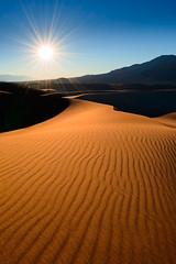 The Desert Sun (Dan Mihai) Tags: california texture nature beautiful contrast sunrise landscape landscapes sand warm pattern shadows desert dunes wideangle deathvalley ripples arid deathvalleynationalpark sidelight mesquiteflatsanddunes mesquiteflatdunes