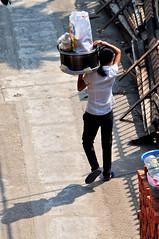 In transit (Roving I) Tags: vertical walking shadows transport vietnam ponytails loads danang carrying alleyways