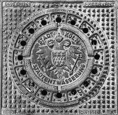 Gully cover of Cologne (gambajo) Tags: old blackandwhite deutschland blackwhite kln gully wappen gullydeckel