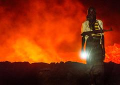 Afar tribe man in front of Erta ale volcano in danakil Ethiopia (Eric Lafforgue) Tags: africa volcano gun border guard ethiopia tribe tension escort ak47 eritrea afar lavaertaale