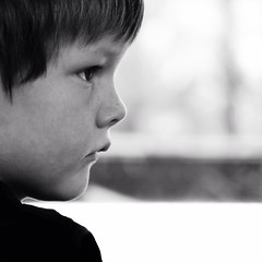 a frown (Pea Jay How) Tags: boy portrait blackandwhite bw monochrome face children square mono child serious profile frown