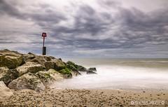 Groyne 1 (Nick_Miles) Tags: longexposure sea sky beach clouds spring sand nikon rocks waves tripod dorset 1870mm hoya groynes hengistburyhead d7000 prond500