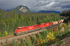 Brief moment of sunshine (Moffat Road) Tags: bridge canada mountains clouds bc britishcolumbia stormy locomotive canadianpacific cp ge ottertail graintrain es44ac