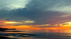 Sea's breath (KerKaya) Tags: ocean leica light sunset sea sky orange lighthouse seascape france reflection nature colors silhouette clouds landscape lumix fire evening coast pier cloudy breath calm cliffs panasonic shore serenity lowtide breeze normandy fz200 kerkaya