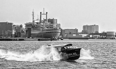 Two icons of Rotterdam. (PvRFotografie) Tags: blackandwhite water monochrome boats boot boat blackwhite rotterdam ship zwartwit ships nederland rotterdamzuid rotterdamcharlois ikazia fujix20 fujifinepixx20