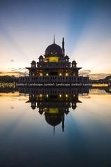 Putra Mosque (Landscape Junkie) Tags: sunrise reflections mosque malaysia putrajaya masjid rayoflight sigma1020mm putramosque masjidputra nikond90 lee09s landscapejunkie muhamadfaisalibrahim