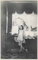 Little girl in a fancy dress stands in front of a lamp (simpleinsomnia) Tags: old white black lamp girl monochrome vintage found blackwhite costume kid child dress little antique snapshot performance photograph shade littlegirl vernacular flapper lampshade foundphotograph