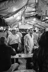 Jamaa el Fna #3 (enzo marcantonio) Tags: africa street leica city travel people blackandwhite bw food night work square outside holidays place outdoor streetphotography eat enzo marocco marrakech souk streetphoto q streetfood summilux ethnicity jamaaelfna marcantonio leicaq enzomarcantonio