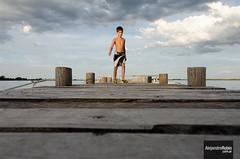 Dock (.Alejandro Rubio.) Tags: camping boy sunset sky lake argentina argentine clouds atardecer muelle dock madera buenosaires cielo nubes salida laguna lobos nio palos alerubio