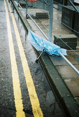 (matthew_coll) Tags: blue abandoned wet yellow umbrella 35mm superia iso fujifilm 800