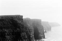 Cliffs of Moher 01 (Ian Atrus Gazzotti  iangazzotti.com) Tags: ireland blackandwhite bw cliff mist fog analog 35mm nikon cliffs bn nebbia moher biancoenero irlanda scogliere scogliera nikonf70 f70