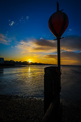 hillhead (veik88) Tags: uk blue sea england sky sun yellow sunrise landscape nikon harbour shingle hampshire solent groin nikond750 nikon20mm18g