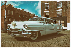 American Beauty: colour version (Reinardina) Tags: wedding england beauty car vintage reflections catalina glamour classiccar ribbons shiny wheels chrome romantic pontiac bouquet 1956 southampton sophisticated fins americanbeauty e11 hirecar whitewalltyres nikfilter stmichaelssquare pontiaccatalina1956