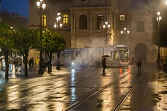 Seville Jan 2016 (12) 040 - Wet and dark in the city - spot the very small child on a bike in close proximity to the tram in very murky and wet conditions (Mark Schofield @ JB Schofield) Tags: santa plaza bridge parque people streets wet public caf rio architecture bar night umbrella reflections river dark ceramic puente graffiti la los spain guadalquivir san expo cathedral maria candid transport iglesia tram seville espana cruz tiles parasol universidad alcazar pavilion oranges harp andalusia cobbles encarnacion luisa giralda isla embankment metropol arenal justa triana macarena remedios cartuja alamillo bernado chapina
