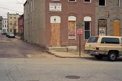 Latrobe St. (centrifugal) (ADMurr) Tags: door leica house 50mm kodak baltimore summicron m4 plywood halfway shut ektar centrifugal