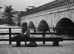Progreso 2 (ram_merval) Tags: mxico puerto puente photography nikon yucatn mirada hombre progreso banca malecn mrida monocromtico d3200